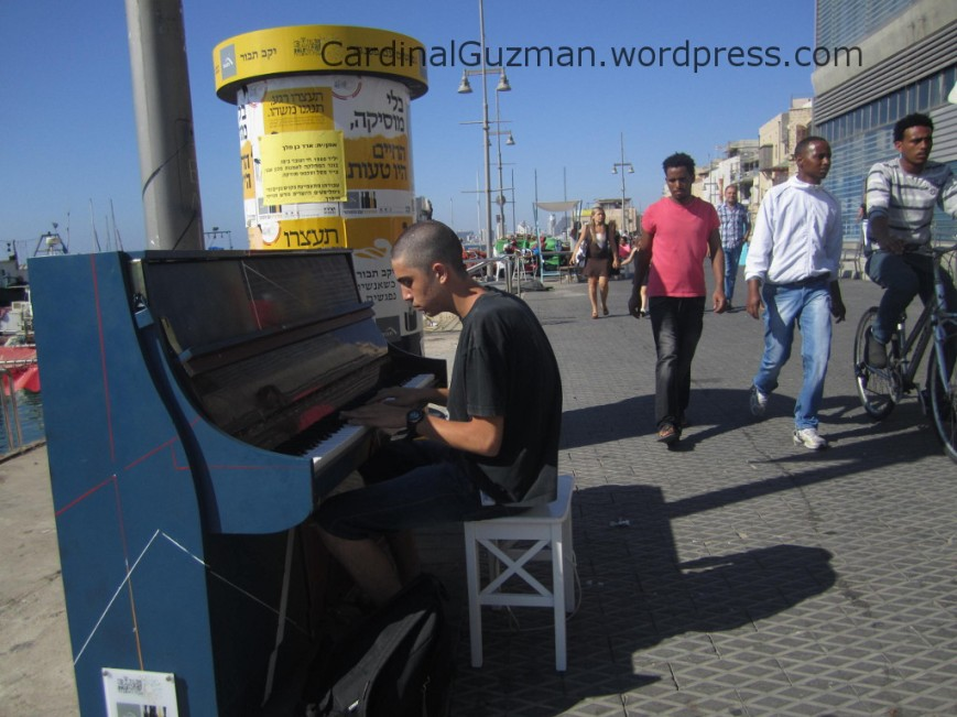 A guy playing piano on the street in Yafo, Tel Aviv